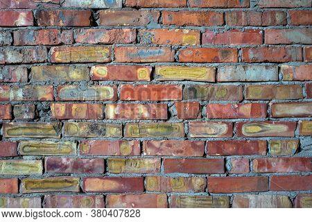 Rough Brickwork Of Low Quality Multicolored Bricks