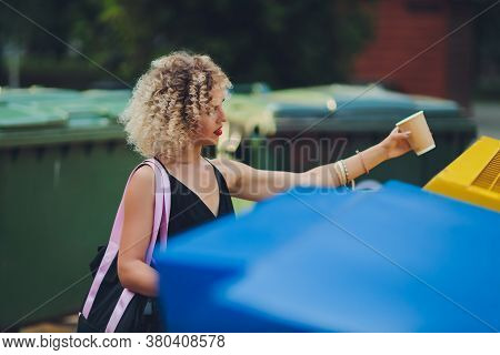 Woman Using Waste Separation Container Throwing Away Coffee Cup Made Of Styrofoam.