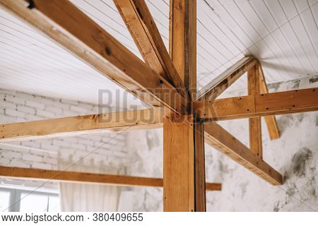 The Construction Of The Wooden Roof. Detailed Photo Of A Wooden Roof Overlap Construction. High Qual