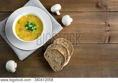 Champignon Soup In A White Bowl On Napkin. Whole Champignons, Bread Flat Lay With Place For Text On