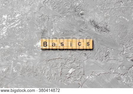 Basics Word Written On Wood Block. Basics Text On Table, Concept