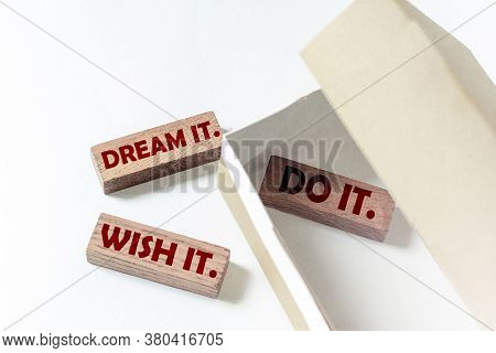 Wooden Blocks With Text Dream It. Wish It. Do It. In A Box On A White Background