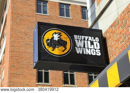 ANN ARBOR, MI - AUGUST 09,2020: Buffalo Wild Wings store sign, Buffalo Wild wings is an American dining restaurant and sports bar franchise in the United States, Canada, India and many countries.