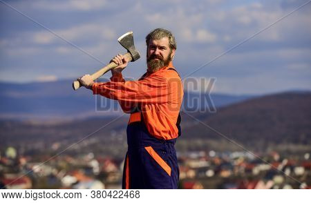 Renovation Tools. Professional Occupation. Man In Uniform Hold Ax. Brutal Bearded Man Axe In Hands.