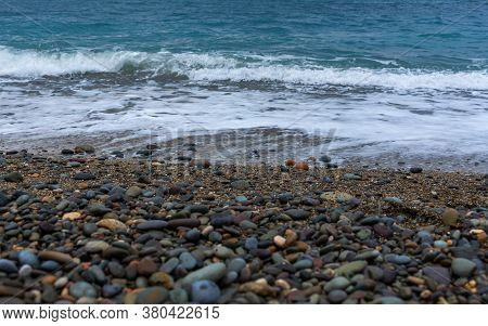 Pebble Beach And Turquoise Water. Texture Of Water And A Pebble. Beach With Clear And Clear Water Vi
