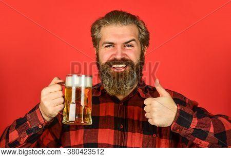 Refresh Your Spirit. Brutal Bearded Man Drink Beer. Beer Pub. Bartender Bar. Man Hold Mug Of Beer. H