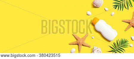 Sunblock Bottle With Starfish And Seashells - Flat Lay