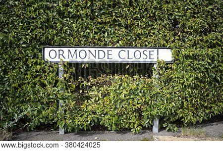 Grantham,linconshire,england - 7 March 2020. Ormonde Close Street Sign Surrounded By Plants In Grant
