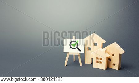 Residential Buildings And Easel With Magnifying Glass And Green Check Mark. Compliance Of Housing Wi