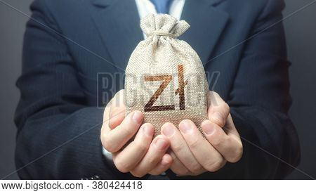 Man Holds Out A Polish Zloty Money Bag. Budget Management, Collect Taxes. Insurance Payout. Financia