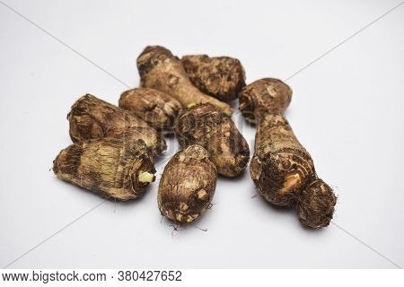 Taro Root On White Background. Colocasia Elephant Ear Plant Root Rhizome Vegetable Also Known As Arb