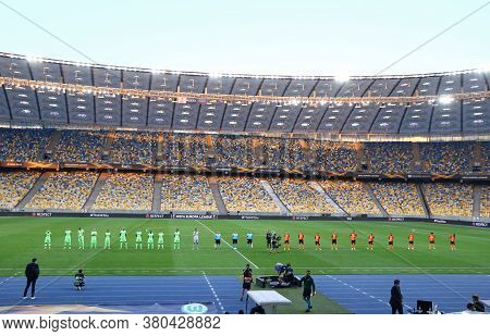 Kyiv, Ukraine - August 5, 2020: Wolfsburg And Shakhtar Donetsk Players Lined Up On The Pitch Before