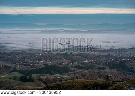 Hastings From The Te Mata Peak Viewpoint In Hawke's Bay, New Zeland. Foggy Morning