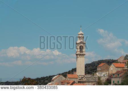 Tall Belltower In A Tiny Village Of Lozisca On The Island Of Brac, Croatia. Beautiful Christian Towe