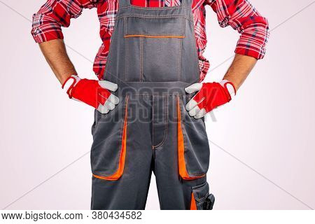 Worker On Strike Against Grey Background. Concept Angry Worker.