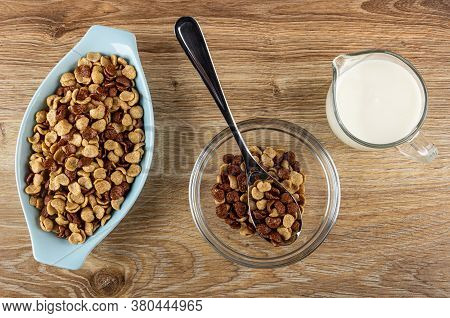 Cereal Grains Breakfast With Chocolate And Caramel In Blue Glass Bowl, Metallic Spoon With Cereal In