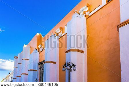 Orange Facade Santa Clara De Asis Church Historic Puebla Mexico.  Clara De Asis Was Female Follower