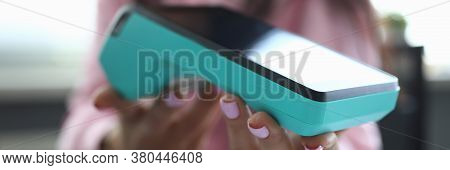 Close-up Of Female Hands Holding Terminal For Payment. Person Paying For Service Or Product. Method