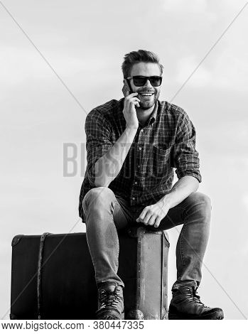 Travel Blogger. Man Sit On Suitcase Before Journey. Business Trip. Handsome Guy Traveler. Guy Outdoo