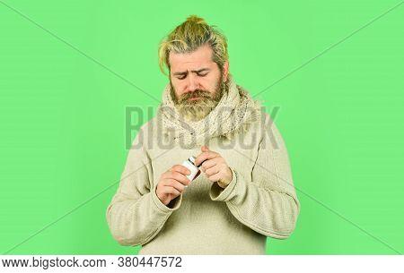 Painkillers Pills. Headache Treatment. Mature Man Taking Pills. Natural And Organic. Helpful Tablets