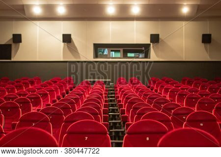 Empty Cinema With Red-black Rows Of Seats. Empty Red Cinema Hall Seats, Chairs. Perspective View 08.