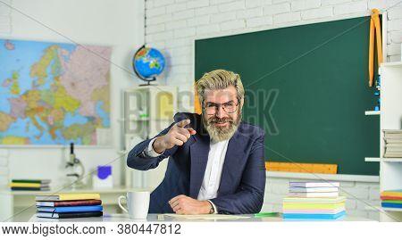 Knowledge Day. Man School Teacher Sit In Classroom. Handsome Mature Smart Educator. Ensure Suitabili
