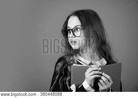 Be Smarty. Smart Girl Brown Background. Little Girl Back To School. Small Girl Read Book In Glasses.