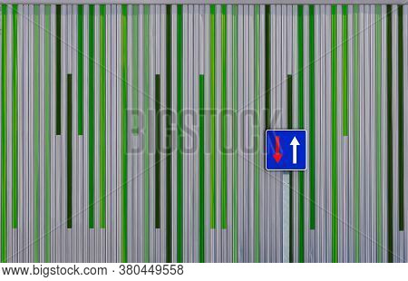 Concept Of Two Colored Walls And A Sign Post, Image Of A Green And An Gray Wall With Blue Sky And Si