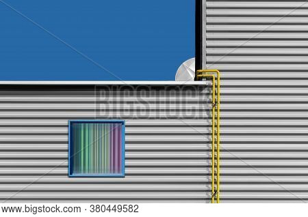 Window And Pipes Concept With Metal Wall, Windows And Architectural Pipes