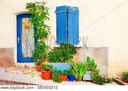 Old Architecture In Valensole, Provence, France. Facade Of The House With Flowers In The Pots