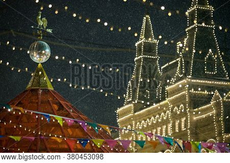 Christmas Holiday Decor In The Center Of Moscow. Christmas Toys Hang On The Branches Of A Tree, And