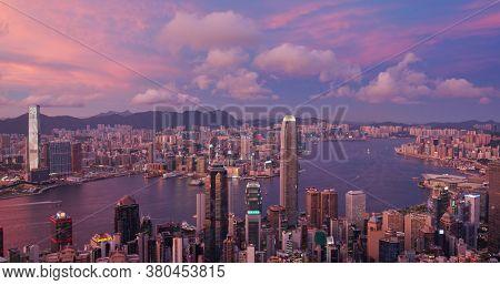 Victoria Peak, Hong Kong 15 July 2020: Hong Kong city skyline at sunset