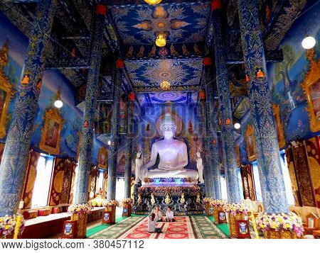 Chiang Rai. Thailand, June 16, 2017: Wat Rong Suea Ten. Three People Are Photographed Inside The Blu