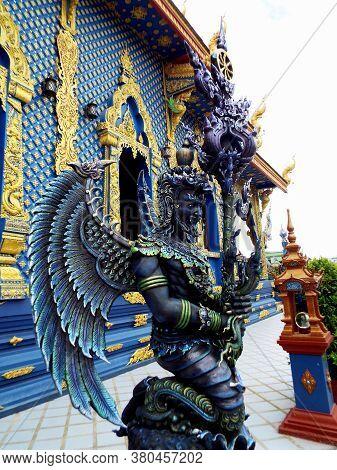 Chiang Rai. Thailand, June 16, 2017: Wat Rong Suea Ten. Winged Blue Sculpture Outside The Blue Templ