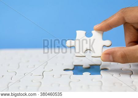 Hand Put The Last Piece Of Jigsaw Puzzle To Complete The Mission. Completing Final Task, Missing Jig