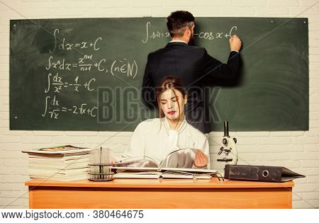 Experiment And Theory. University Student With Teacher Making Research Experiment. Pretty Woman And