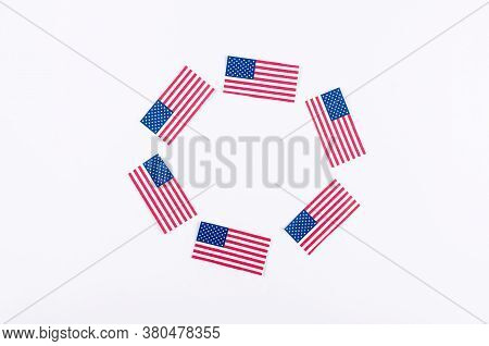 American Flag And Confetti In National Colors Of America On A White Background In The National Color