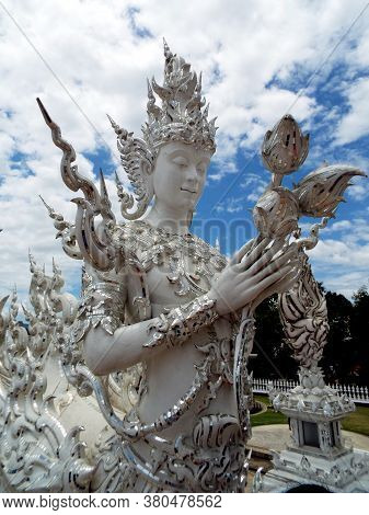 Chiang Rai. Thailand, June 17, 2017: Wat Rong Khun. One Of The Sculptures From The White Temple In C