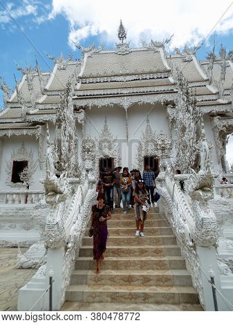 Chiang Rai. Thailand, June 17, 2017: Wat Rong Khun. People Walking Down One Of The Side Stairs Of Th