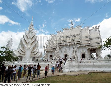 Chiang Rai. Thailand, June 17, 2017: Wat Rong Khun. General View With Numerous People Visiting The W