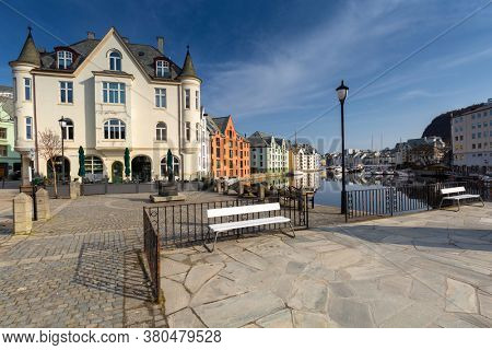 Alesund, Norway - April 14, 2018: Beautiful architecture of Alesund at sunny day, Norway