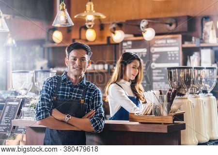 Portrait Of Asian Young Small Business Owner With Coffee Shop In Front Of Counter Bar, Entrepreneur