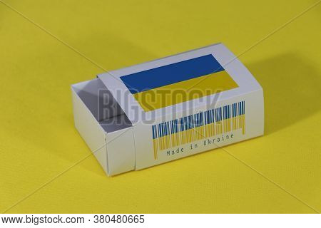 Ukraine Flag On White Box With Barcode And The Color Of Nation Flag On Yellow Background, Paper Pack