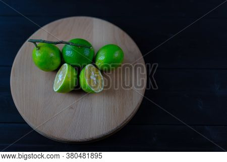 Green Ripe Lime On Wooden Background.green Ripe Lime On Wooden Background