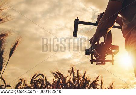 Videography And Cinema Industry Theme. Scenic Sunset Cinema Shot Using Digital Slr Camera And Gimbal