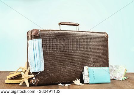 Safe Travel Concept Retro Suitcase With Passport Travel Accessories And Medical Mask Observance Of T