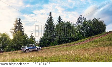 Off Road Car Going The Mountain Road At Sunset Travel By Car Concept Background