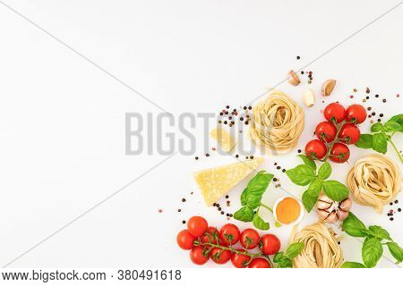 Iettuccine With Ingredients For Cooking Italian Pasta On White Background Top View