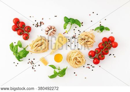 Fettuccine With Ingredients For Cooking Pasta On White Background Top View Flat Lay