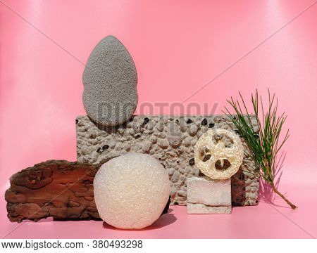 Variety Of Cleansing Sponges On Natural Stone Podiums. Konjac And Loofahs Sponges, Face Cleaning Spo